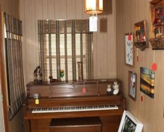 Piano ( needs tuning) Pictures on the wall, and a vintage hanging lamp in the front hall