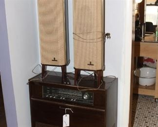 Mid century stereo console with turntable inside underneath the dials