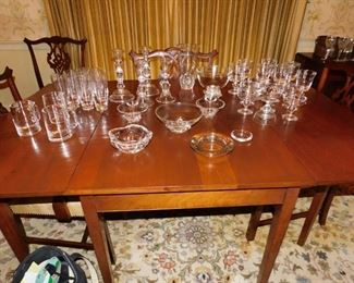 Large collection of Steuben crystal to include goblets and champagne/sherbets in the Square Bowl pattern, numerous Steuben vases, a three-piece console set, beer mugs, highball glasses and pairs of candlesticks