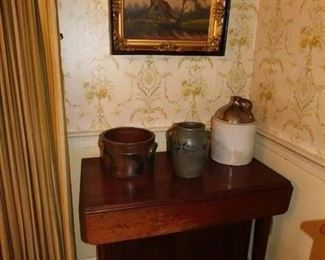 Mid-19c oil on canvas, antique crocks to include two Virginia salt glaze crocks likely Richmond and an unusual small drop leaf table with a cupboard mounted in it.
