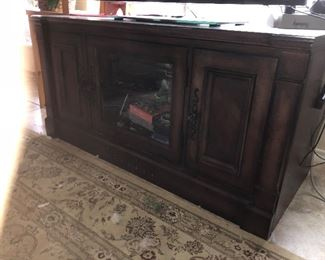 not good lighting but large screen TV cabinet.