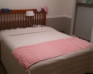 Queen size bed.  Includes mattress, box spring, bed frame and linens.