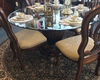 Beautiful Pecan Wood Pedestal Table and 4 chairs with glass top.  Egyptian Round 8' carpet and rug.  No stains. Immaculate condition.