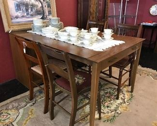Wonderful 1960's Pull out table with 3 leaves.  This folds up to become a credenza.  Just beautiful and wonderful for a small space for great dining.
