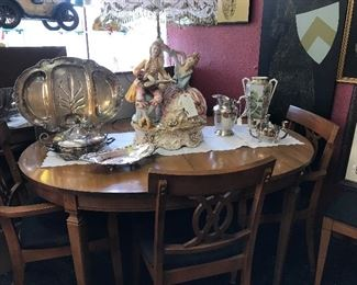 Beautiful vintage table has been reduced.  2 leaves and 6 chairs.  It is a peach.  Lots of Silver serving items. Capo Di Monte Lamp.  We have had it for awhile, so would like to get it sold.