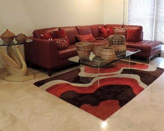 LEATHER SECTIONAL SOFA, GLASS COFFEE TABLE AND RUG