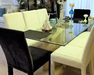 Great dining table and chairs. 6 white chairs come with the set. There are 4 extra black chairs for sale too. Just like new! The base of this table is incredible.
