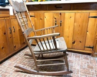 49. Antique Carved Rocking Chair