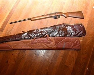 90. Winchester 22 Rifle and Cases