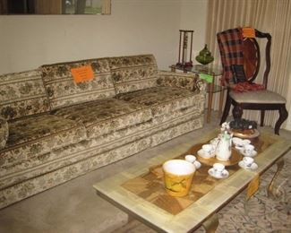 Sofa with mahogany chair and marble top coffee table
