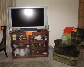 Book case with flat screen TV and arm chair