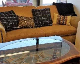 Like new sofa and pillows and throws and coffee table