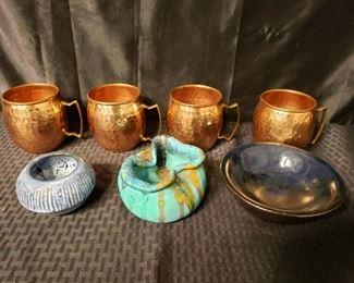 4 copper mugs and 3 ceramic bowls