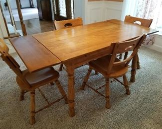 """Lot # 1 - $350  Vintage Dining Room Table & Four Chairs with pull out end leafs that pull up and then out to extend this beautiful table. (2 ft. 8"""" wide & 5 ft. 8 """" long)  Age is 60+ years. Perfectly maintained!"""