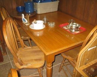 oak table with 4 swivel oak chairs
