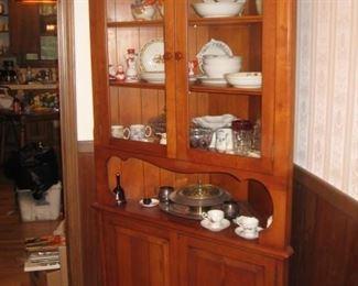 One of 2 cherry corner cabinets