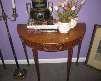 One of a pair of demilune tables