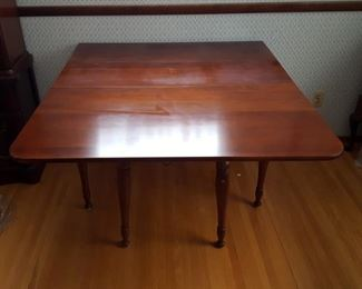 Cherry drop leaf table with leaf and pads