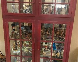 Red cabinet filled with collectibles. Red cabinet is not for sale