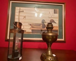 Brass lanterns and large duck painting