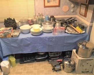 Kitchenware items:  saucepans, pitchers, bowls, a muffin tin, and more.