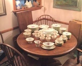 One of the dining table and chair sets (with extension) and a dishware set.