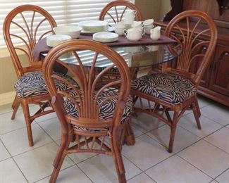Rattan table with glass top and four (4) chairs
