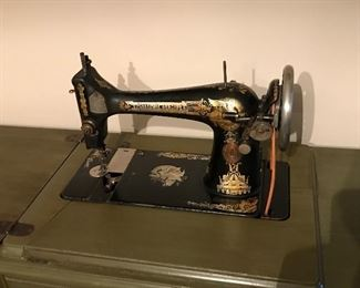 Antique Singer sewing machine.  The cabinet has been restored.