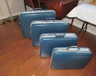 Vintage hard vinyl blue luggage set