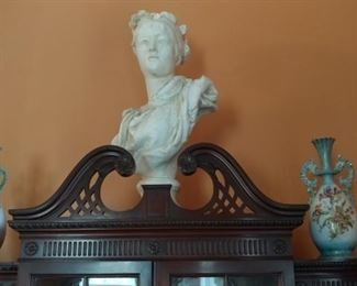 Contemporary bust and old vases