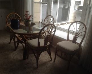 Bamboo table with glass top and 4 chairs....$275.  Has never been outside.