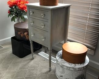 Selection of lidded wood boxes and small painted chest/side table. Great selection of furniture throughout the condo.