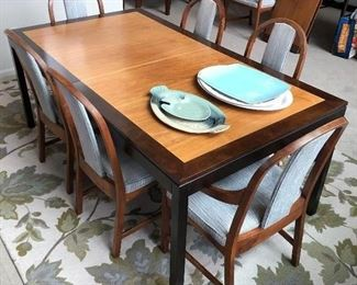 Dining table with eight chairs, two additional leaves, and pads.  Originally purchased at Klingman's.