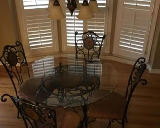 Unique black Wrought Iron kitchen Table with round center design that matches back of chairs. Like new and very nice!
