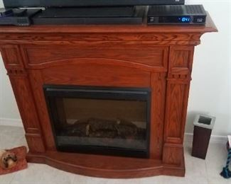 Electronic fireplace , faux flame w/ mantel . Heats up the room !