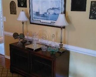 Entertainment center, crystal decanter & candle holder, William McGrath Monitor and Merrimack battle print