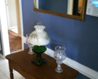 Vintage hall table, converted oil lamp, crystal candle holders, gold leaf wall mirror