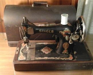 Antique Singer sewing machine with case and key