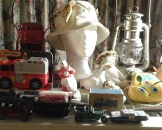 matchbox cars, matchbox vintage empty box (mint), tin friction car (as is), fishing lures, Roseville Rozane  pottery vase, lanterns and more
