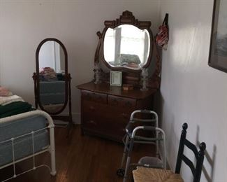 Large antique dresser with mirror Green chairs
