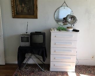 Old school Tv's   Nice rug  white chest of drawers