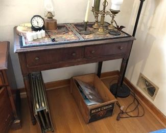 Lamps, candle holders, old stand/table.