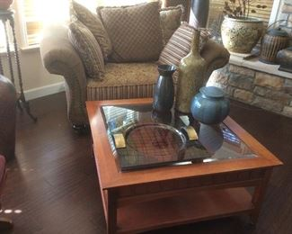Oversized chair with pillows, coffee table, decor items