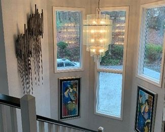 Wonderful Itzchak Tarkay Prints line the stairwell as you ascend to the second story.  There are wonderful hanging metal sculptures as well.