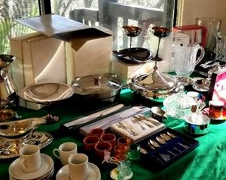 Table full of kitchen and host goodies