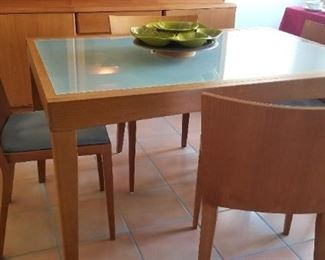 Another view of the dining table and chairs