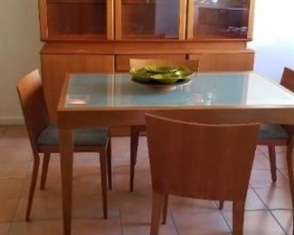 View of mid-century hutch and mid-century dining table and chairs