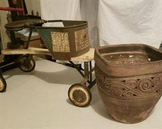 Vintage push cart and terracotta flower pot