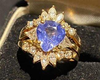 Estate Ring.  Pear Shaped Tanzanite stone setting  with two trilliant cut diamonds 14k gold ring with 14k gold enhancer ring with six small marquise cut diamonds and eight small round brilliant cut diamonds.  (Photos by BC)