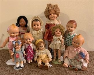 Composition dolls including Shirley Temple, Madame Alexander, Kewpie and Patsy.